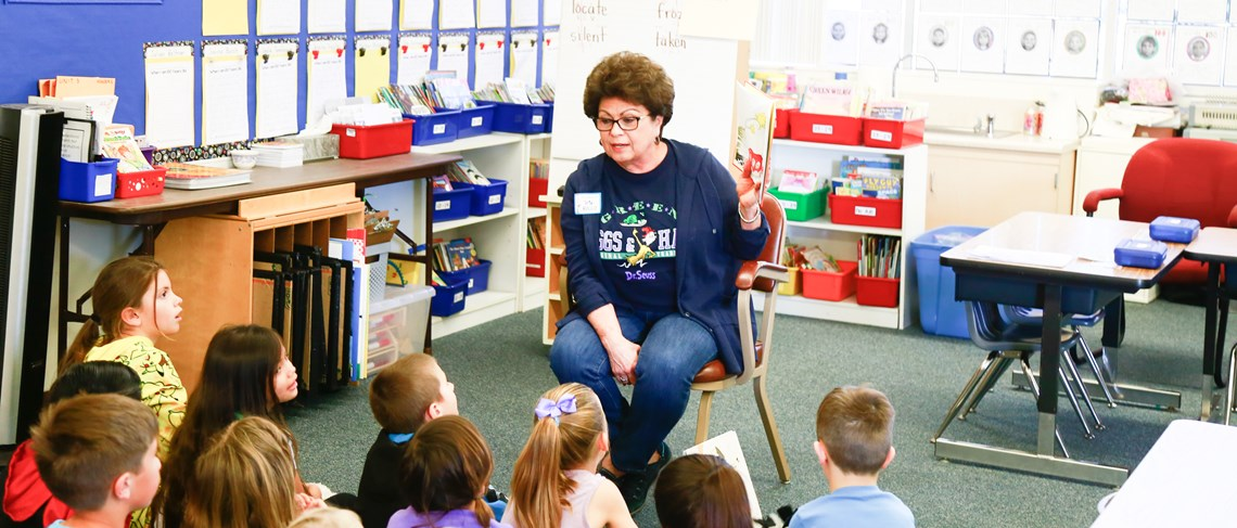 Students enjoy a visit from Board of Education Trustee Teri Rocco for Read Across America Day!